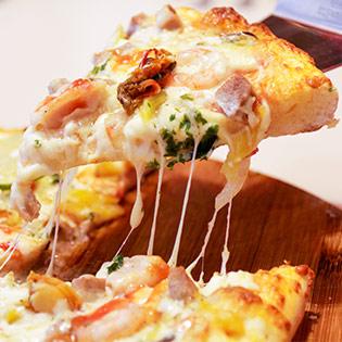 Thưởng Thức Hương Vị Pizza Ý Tại Hệ Thống Pizza REX